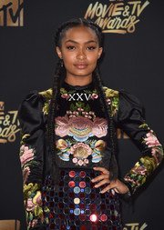 Yara Shahidi looked romantic with her double French braids at the 2017 MTV Movie and TV Awards.