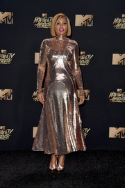 Taraji P. Henson matched her fab frock with gold platform sandals by Casadei.
