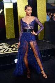 Jasmine Tookes completed her sexy look with black Tamara Mellon Frontline sandals.