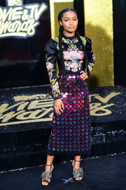 Yara Shahidi added more sparkle with a pair of bedazzled bow sandals, also by Gucci.