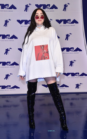 Noah Cyrus ditched the pants in favor of these black patent thigh-high boots.