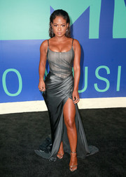 Christina Milian complemented her gown with a pair of silver slim-strap sandals.
