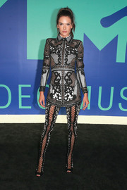Alessandra Ambrosio amped up the fierceness with a pair of hip-high lace-up boots, also by Balmain.