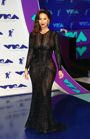 Amber Rose flaunted her voluptuous figure in a sheer black Yousef Al-Jasmi gown at the 2017 MTV VMAs.