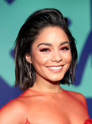 Vanessa Hudgens matched her red eyeshadow to her dress.