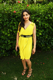 Freida Pinto finished off her dress with a pair of gold and black triple-strap heels.