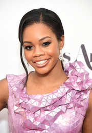 Gabrielle Douglas attended the 2017 Miss America competition wearing this elegant side-parted ponytail.