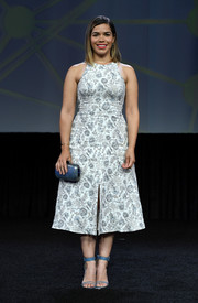 America Ferrera styled her dress with blue ankle-strap sandals by Tamara Mellon.