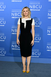 Kristen Bell injected a splash of color with a pair of mustard Louboutins.