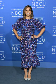 America Ferrera paired her vibrant dress with simple white mesh-panel pumps.