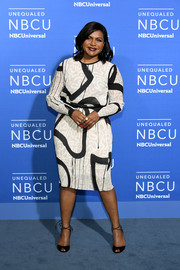 Mindy Kaling wore a long-sleeve midi dress that featured an eye-catching abstract print to the 2017 NBCUniversal Upfront.