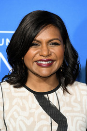 Mindy Kaling attended the 2017 NBCUniversal Upfront wearing her hair in feathery waves.
