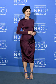 Jaimie Alexander looked sultry in a figure-hugging aubergine cutout dress by Cushnie et Ochs at the 2017 NBCUniversal Upfront.