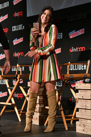 Chloe Bennet looked adorably mod in her multicolored wrap dress and knee-high boots combo during New York Comic Con 2017.