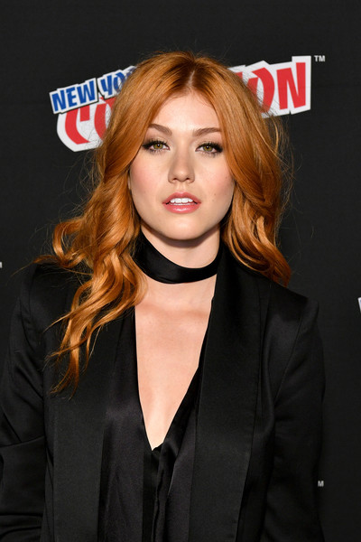 Katherine McNamara wore her hair in a cascade of flaming waves during New York Comic Con 2017.