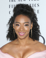 Betty Gabriel wore her curls in a poofy half-up style at the New York Film Critics Awards.