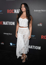 Demi Lovato looked sensual in a white lace corset top by Milly at the 2017 Roc Nation pre-Grammy brunch.