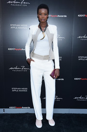 Maria Borges was sporty in a white pantsuit with taupe panels at the 2017 Stephan Weiss Apple Awards.
