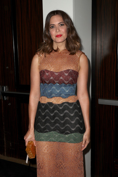 Mandy Moore paired a pearlized gold box clutch by Edie Parker with a color-block dress for the TCA Awards.