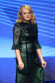 Elisabeth Moss sported a green Edie Parker box clutch and a matching dress at the TCA Awards.