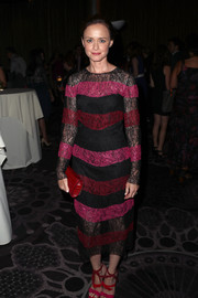 A red crocodile clutch rounded out Alexis Bledel's look.