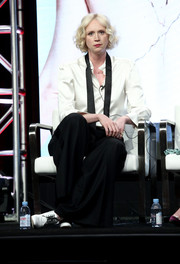 Gwendoline Christie completed her outfit with baggy black trousers.