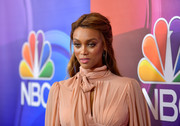 Tyra Banks styled her hair into a half-up 'do with a shallow side part for the 2017 Summer TCA Tour.
