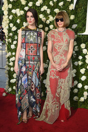 Anna Wintour looked playfully glam in a red gown with a beige butterfly-motif net overlay at the 2017 Tony Awards.