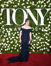 Sally Field was classic and glam in a feather-festooned navy off-the-shoulder gown at the 2017 Tony Awards.