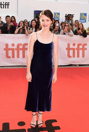 Claire Foy continued the minimalist vibe with a pair of burgundy velvet heels by Jimmy Choo.
