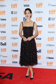 Katherine Waterston kept it fun and chic at the TIFF premiere of 'The Current War' in a black Dior cocktail dress that was studded all over with multicolored pompoms.