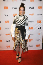 Ruth Wilson went for an ultra-feminine finish with a gold brocade ruffle skirt, also by Johanna Ortiz.