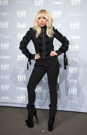 Lady Gaga matched her jacket with a pair of black tuxedo trousers by Aquilano.Rimondi.