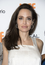 Angelina Jolie went for classic styling with a pair of diamond hoops by Butani.