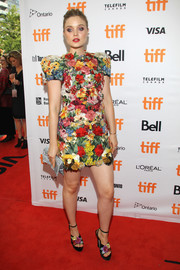 Bella Heathcote looked totally charming in a flower-festooned Dolce & Gabbana dress at the TIFF premiere of 'Professor Marston and the Wonder Women.'
