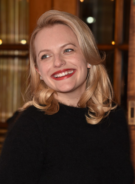 Elisabeth Moss styled her hair with bouncy curls for the TIFF premiere of 'The Square.'