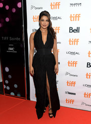 Priyanka Chopra cut a shapely silhouette in a black Zaid Affas halter gown with a cinched-in waist and a high front slit at the 2017 TIFF Soiree.