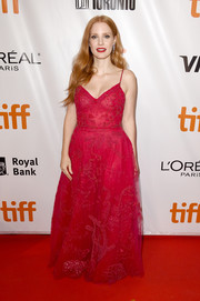 Jessica Chastain enchanted in a delicately embellished red ball gown by Zuhair Murad at the TIFF premiere of 'Woman Walks Ahead.'