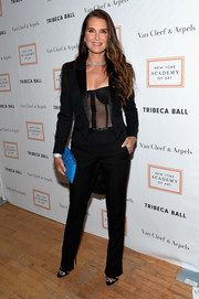 Brooke Shields punctuated her black outfit with a bright blue crocodile clutch.