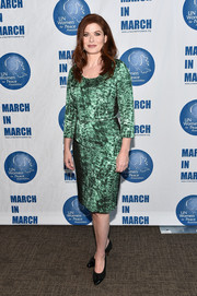 Debra Messing kept it classy in a metallic-green print dress at the UN Women for Peace Association luncheon.