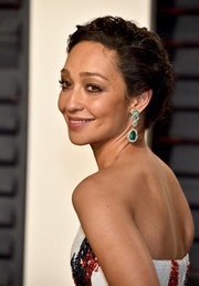 Ruth Negga glammed up her look with a pair of emerald and diamond drop earrings by Verdura for Gemfields when she attended the Vanity Fair Oscar party.