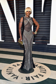 Mary J. Blige teamed her dress with a metallic box clutch.