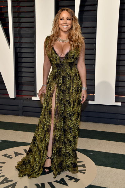 Mariah Carey flaunted her ample cleavage in a low-cut print gown by Philipp Plein at the Vanity Fair Oscar party.