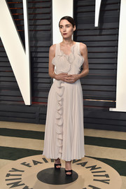 Rooney Mara paired her frock with black platform sandals by Jimmy Choo.