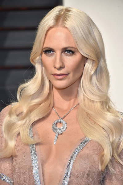 Poppy Delevingne looked like Barbie with her platinum-blonde waves at the Vanity Fair Oscar party.