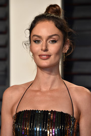Nicole Trunfio attended the Vanity Fair Oscar party wearing her hair in a casual top knot.