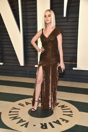 Katy Perry was edgy-glam in an asymmetrical bronze sequin gown by Jean Paul Gaultier Couture at the Vanity Fair Oscar party.