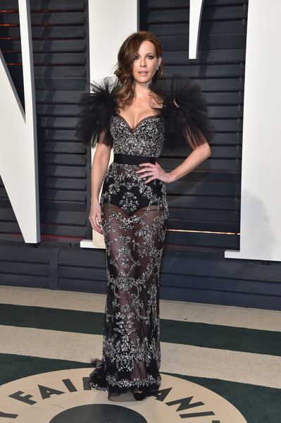Kate Beckinsale attended the Vanity Fair Oscar party decked out in a sheer black Zuhair Murad gown with silver beading and ruffle sleeves.