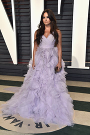 Demi Lovato went the ultra-sweet route in a lilac Monique Lhuillier gown with a voluminous ruffle skirt when she attended the Vanity Fair Oscar party.