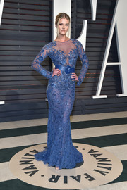 Nina Agdal was equal parts sexy and elegant in a sheer, embellished blue gown by Zuhair Murad Couture at the Vanity Fair Oscar party.